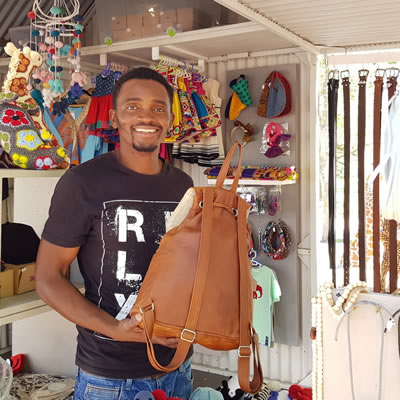Aleck Mhizha – Leather for Life – with his leather bags and accessories