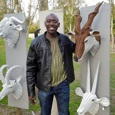 George Dokora with his beaded wirework trophy heads