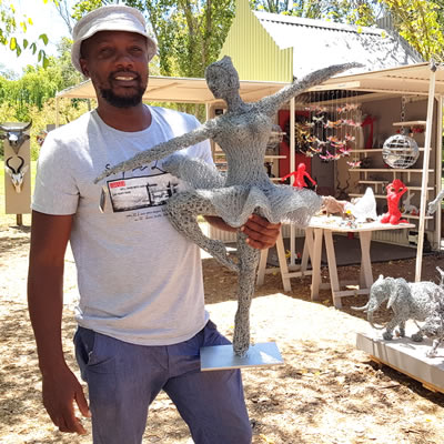 Jeff Mwazha with his crushed wire sculptures