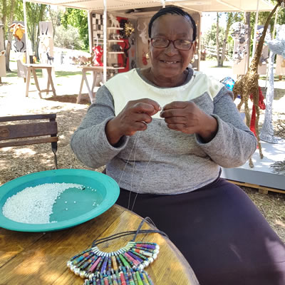 Maria Sikinya with her beaded jewellery