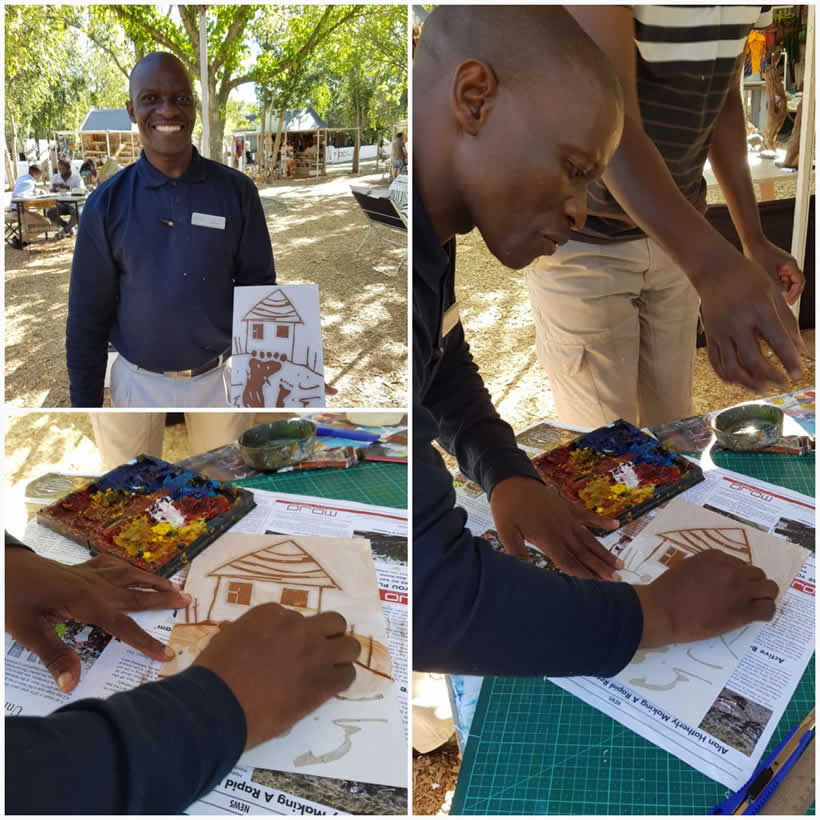 Zach Mukwira making experience for staff at Spier Craft Market