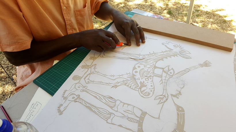 Zach Mukwira working on an artwork at Spier Craft Market